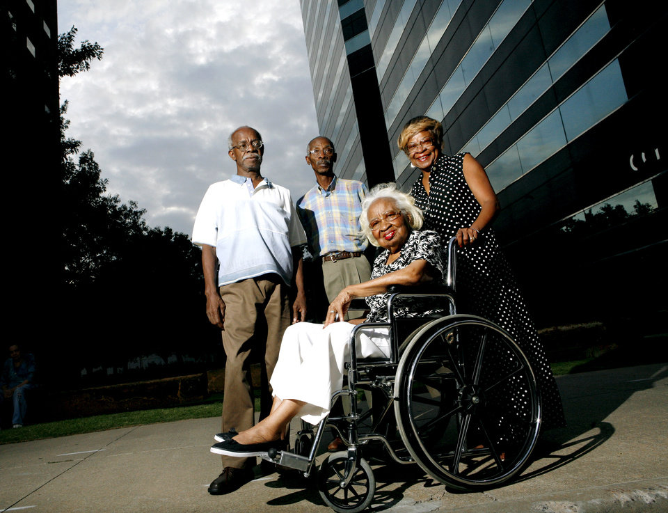 Photo - SIT-INS: Calvin Luper, Richard Brown and Marilyn Luper Hildreth pose with Clara Luper near the old Katz Drug Store at Main and Robinson in Oklahoma City on Tuesday, August 6, 2008. By John Clanton, The Oklahoman ORG XMIT: KOD