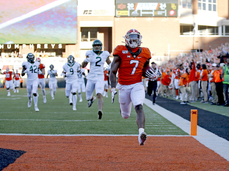 Photo - Oklahoma State's LD Brown (7) scores on the fourth quarter during the college football game between Oklahoma State University and Baylor at Boone Pickens Stadium in Stillwater, Okla., Saturday, Oct. 19, 2019. Baylor won 45-27. [Sarah Phipps/The Oklahoman]