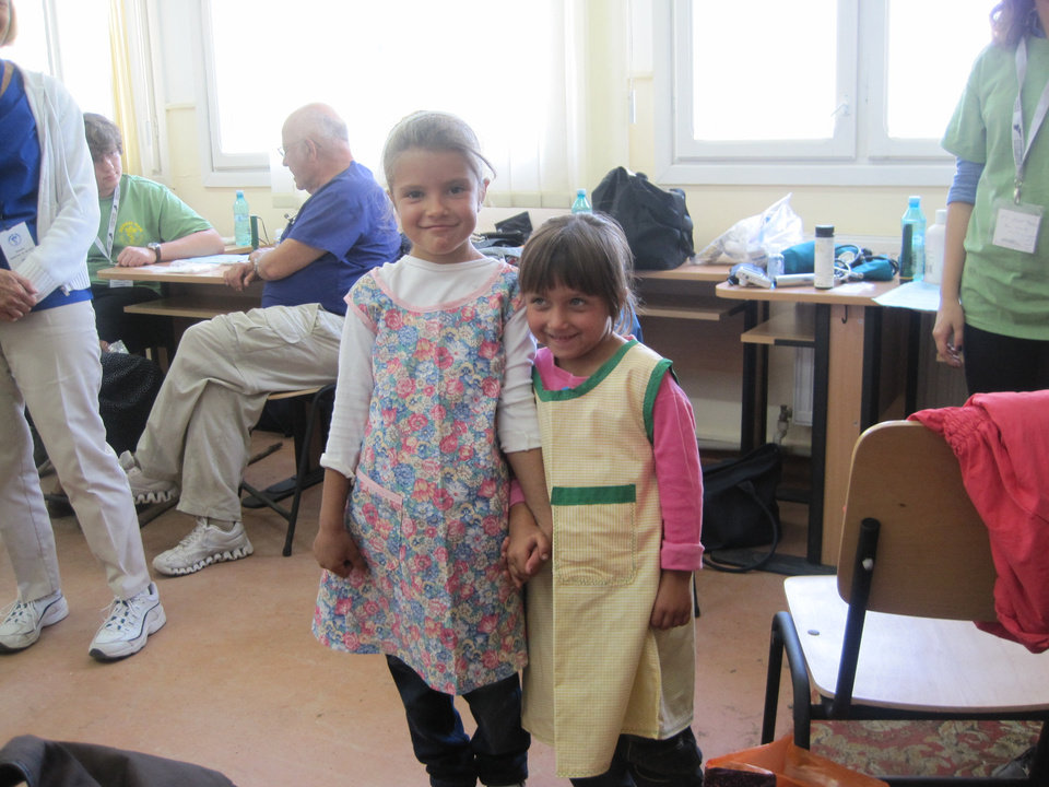 Photo - Two girls wear dresses made by Faye Flowers. Photo provided by Feed The Children.