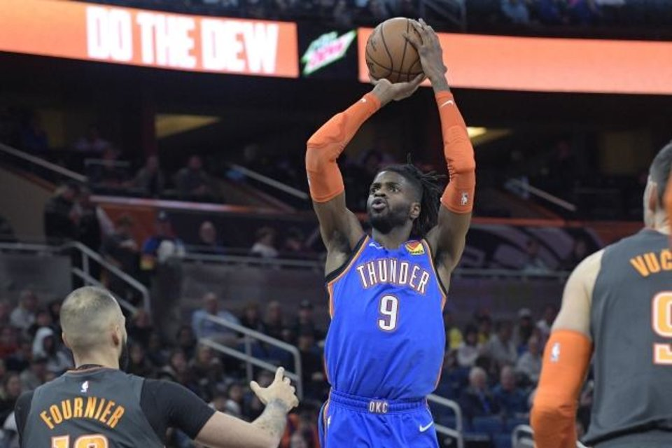 Photo -  Oklahoma City's Nerlens Noel goes up for a shot during Wednesday night's game in Orlando. Noel helped OKC beat the Magic 120-114. [AP Photo/Phelan M. Ebenhack]