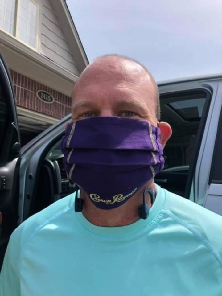 Photo -  This reader shows even the cloth covering his Crown Royal bottle was good enough to make a mask. [Photo provided]