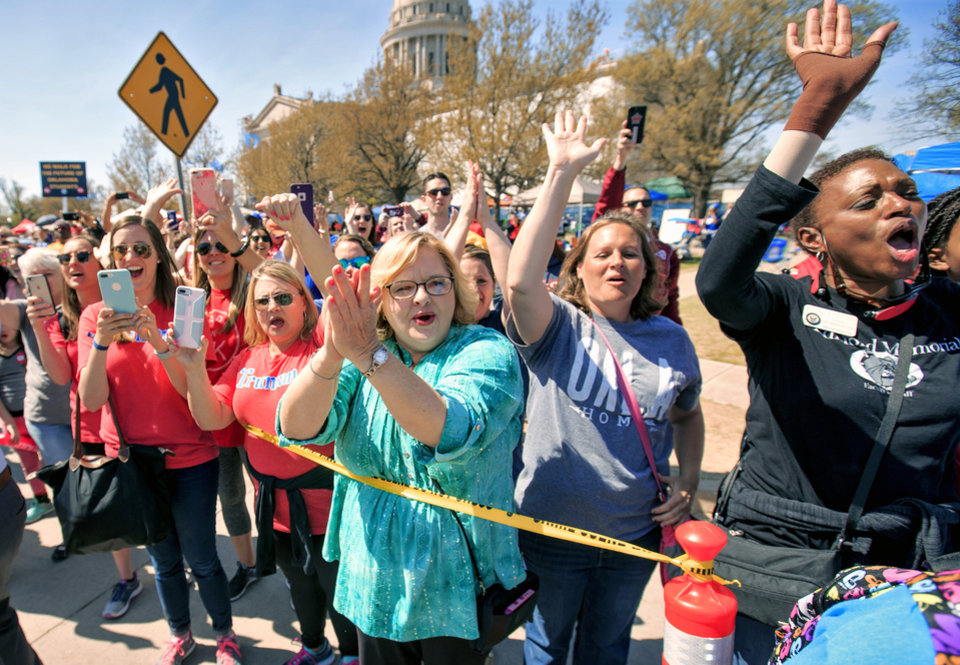 Photo - Supporters cheer on Tulsa teachers as they arrive to the Capitol to finish their 110 mile walk from Tulsa during the ninth day of a walkout by Oklahoma teachers at the state Capitol in Oklahoma City, Okla. on Tuesday, April 10, 2018.   Photo by Chris Landsberger, The Oklahoman