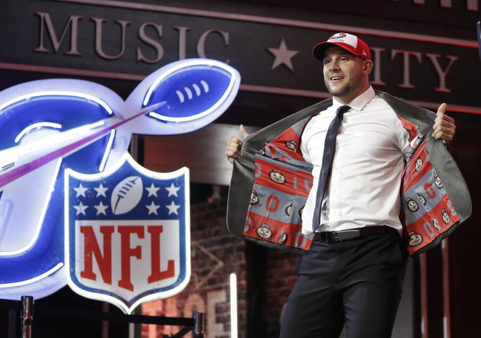 Photo - Ohio State defensive end Nick Bosa walks the stage after the San Francisco 49ers selected Bosa in the first round at the NFL football draft, Thursday, April 25, 2019, in Nashville, Tenn. (AP Photo/Mark Humphrey)