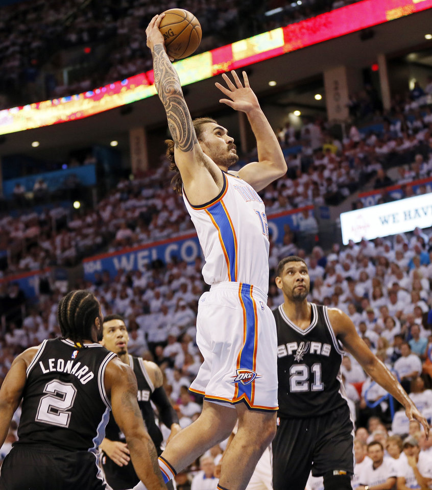 Photo - Oklahoma City's Steven Adams (12) dunks the ball past San Antonio's Kawhi Leonard (2), Danny Green (14) and Tim Duncan (21) during Game 4 of the Western Conference semifinals between the Oklahoma City Thunder and the San Antonio Spurs in the NBA playoffs at Chesapeake Energy Arena in Oklahoma City, Sunday, May 8, 2016. Photo by Nate Billings, The Oklahoman