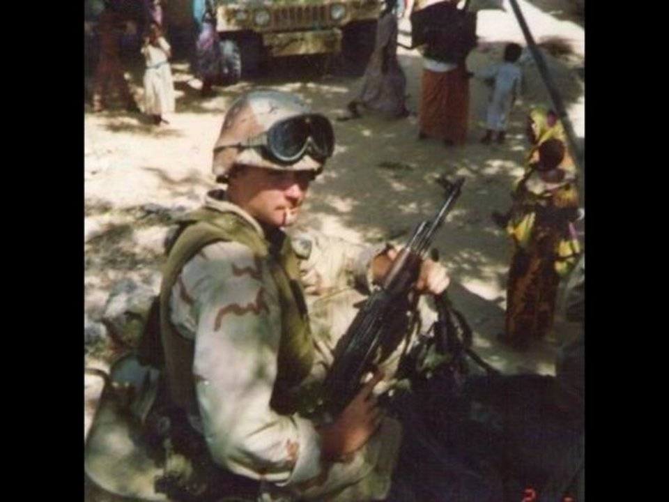 Photo -  Chris Sanford, president of the Wolfpack association, looked like this back in his Marine Corps active duty days in Mogadishu, Somalia. Sanford now lives in Edmond.