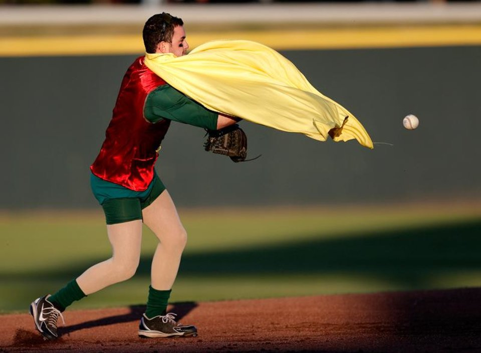 Photo -  Robin, Joshua Ake, tries to throw to second during University of Oklahoma's baseball's  ALS Awareness Halloween Game at L. Dale Mitchell Park in Norman, Okla. , Thursday, Oct. 24, 2013. Photo by Sarah Phipps, The Oklahoman