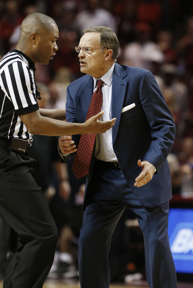Photo - Oklahoma head coach Lon Kruger talks with a referee as the University of Oklahoma Sooner (OU) men defeat the West Virginia Mountaineers (WV) 70-68 in NCAA, college basketball at The Lloyd Noble Center on Jan. 16, 2016 in Norman, Okla. Photo by Steve Sisney, The Oklahoman