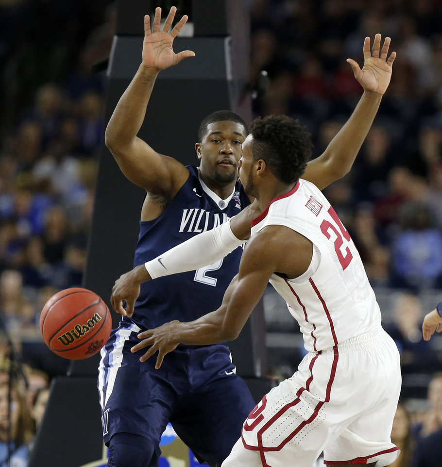 Photo - Oklahoma's Buddy Hield (24) passes around Villanova's Kris Jenkins (2) during the national semifinal between the Oklahoma Sooners (OU) and the Villanova Wildcats in the Final Four of the NCAA Men's Basketball Championship at NRG Stadium in Houston, Saturday, April 2, 2016. Photo by Nate Billings, The Oklahoman