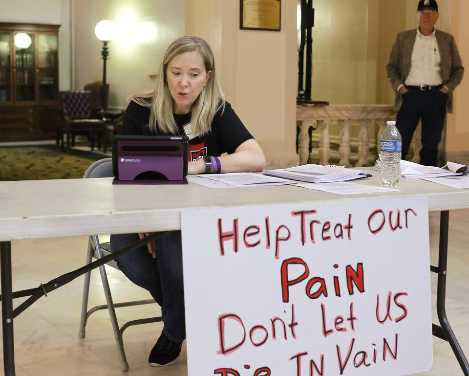 Photo -  Kari Kruska attended the Don't Punish Pain rally on Tuesday at the state Capitol. [Photo by Jim Beckel, The Oklahoman]