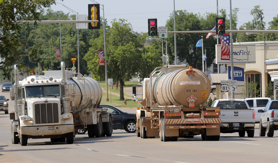 Photo -  Tanker trucks are a common sight on on U.S. 81 in Kingfisher, as companies are busy in the area producing oil and natural gas. [The Oklahoman Archives]