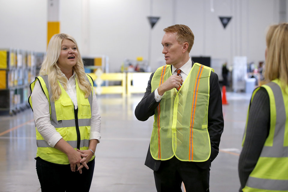 Photo -  Straightaway Delivery co-owner Erica Stone talks with U.S. Sen. James Lankford during a tour Tuesday of the new Amazon Delivery Center at 4401 E Hefner. [Photos by Bryan Terry, The Oklahoman]