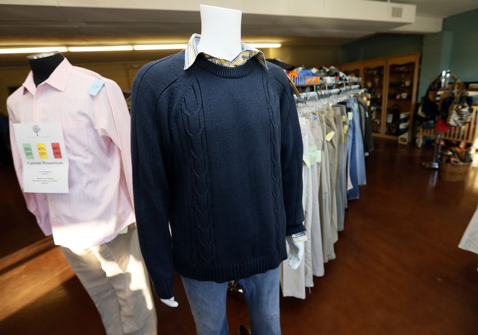 Photo - Clothing is among items for sale at the new Shidler-Wheeler Community Thrift Store, 735 SE 15t opened recently by FaithWorks of the Inner City.   NATE BILLINGS - NATE BILLINGS