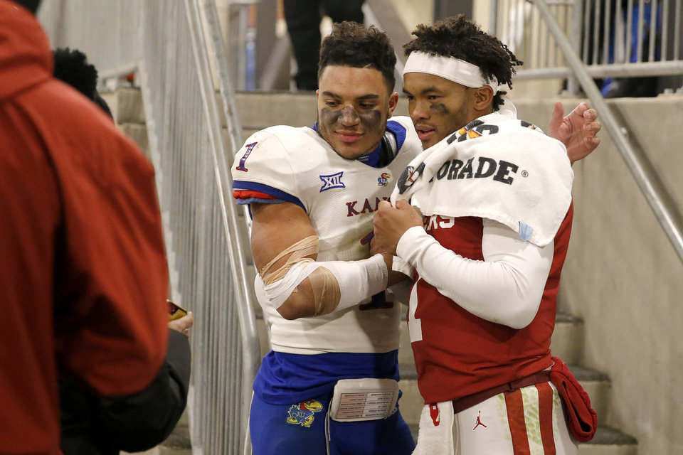 Photo - Oklahoma's Kyler Murray (1) greets Kansas' Bryce Torneden (1) after a college football game between the University of Oklahoma Sooners (OU) and the Kansas Jayhawks (KU) at Gaylord Family-Oklahoma Memorial Stadium in Norman, Okla., Saturday, Nov. 17, 2018. Photo by Bryan Terry, The Oklahoman