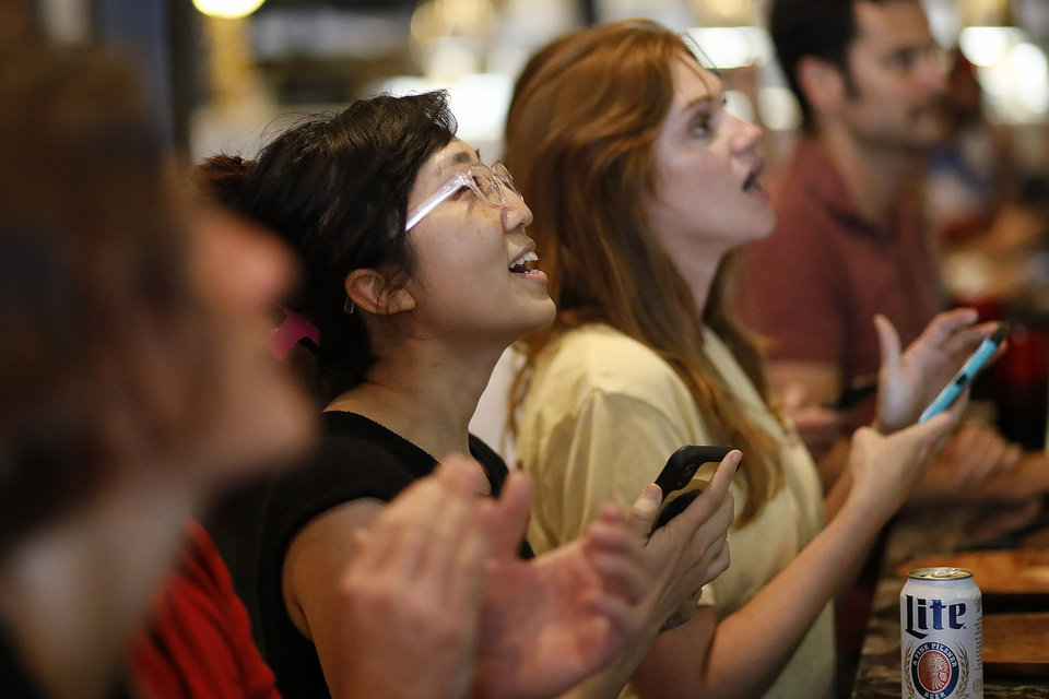Photo -  Fans watch television coverage of the United States' match against Thailand in France at soccer's Women's World Cup, Thursday, June 11, 2019, in Athens, Ga. (Joshua L. Jones/Athens Banner-Herald via AP)
