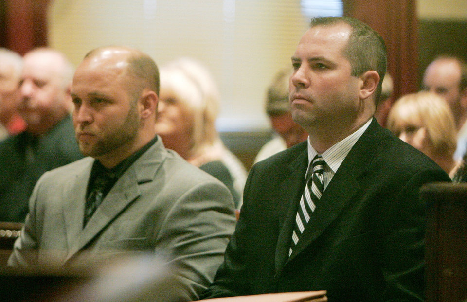 Photo - Former Noble police officers Robert Shawn Richardson and Paul Bradley Rogers sit in the courtroom during their sentencing hearing Monday, March 31, 2008. The officers are accused of firing shots in an attempt to kill a snake stuck in a birdhouse.  The officers were charged with second-degree manslaughter after one of two shots struck and killed 5-year-old Austin Haley as he fished with his grandfather Jack Tracy on a nearby lake. OKLAHOMAN ARCHIVES PHOTO  Jaconna Aguirre - THE OKLAHOMAN