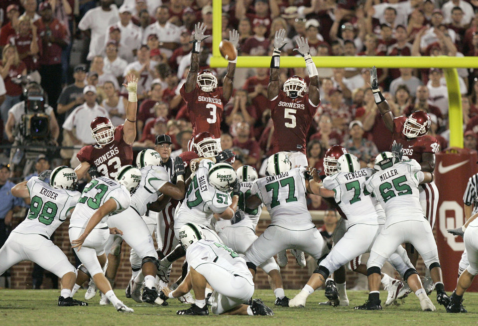 Photo - Oklahoma Sooners defenders Reggie Smith (3) and Nic Harris (5) jump in a failed attempt to block a North Texas field goal by Thomas Moreland (23) in the second half during the University of Oklahoma Sooners (OU) college football game against the University of North Texas Mean Green (UNT) at the Gaylord Family - Oklahoma Memorial Stadium, on Saturday, Sept. 1, 2007, in Norman, Okla. OU defeated North Texas 79-10.