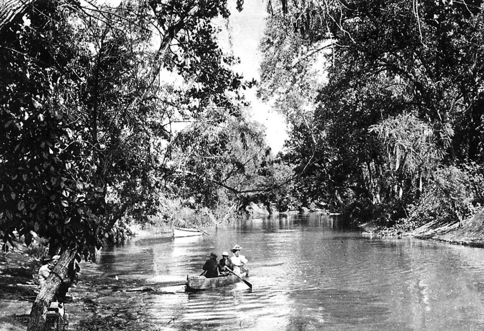 Photo -  The Oklahoma River, known as the North Canadian River and shown in this photo during the earliest days of the city, was an oasis of trees along a meandering prairie river during the first 20 years after the 1889 Land Run. This photo was taken along Wheeler Park. [Oklahoman Archives Photo]