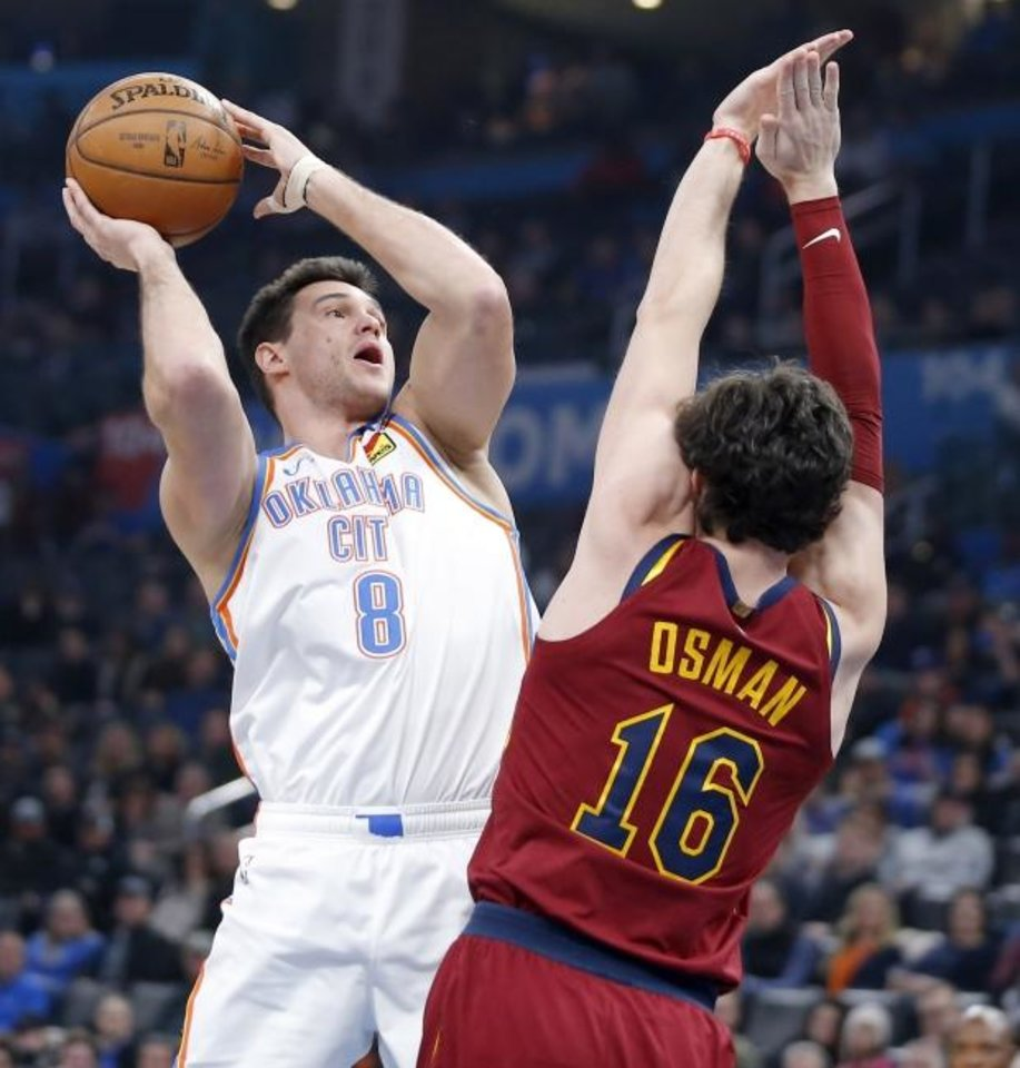 Photo -  Oklahoma City's Danilo Gallinari, left, attempts a shot beside Cleveland's Cedi Osman  during Wednesday night's game at Chesapeake Energy Arena. [Bryan Terry/The Oklahoman]