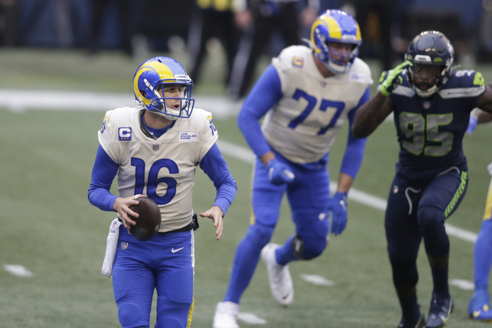 Photo -  Los Angeles Rams quarterback Jared Goff (16) scrambles as he looks for room to pass against the Seattle Seahawks during the first half of an NFL wild-card playoff football game, Saturday, Jan. 9, 2021, in Seattle. (AP Photo/Scott Eklund)