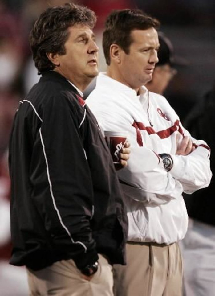 Photo - Texas Tech head coach Mike Leach and Oklahoma head coach Bob Stoops, from left, talk before the 2006 game. Photo by Bryan Terry