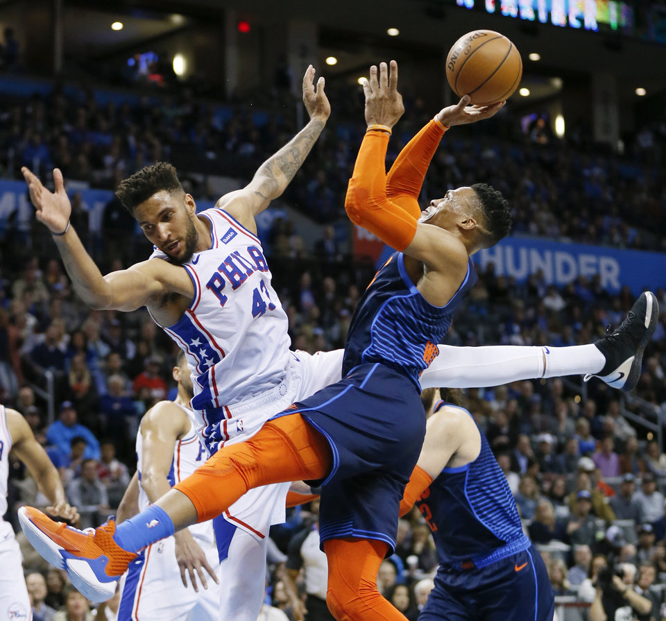 Photo - Oklahoma City's Russell Westbrook (0) shoots against Philadelphia's Jonah Bolden (43) in the first quarter during an NBA basketball game between the Philadelphia 76ers and the Oklahoma City Thunder at Chesapeake Energy Arena in Oklahoma City, Thursday, Feb. 28, 2019. Photo by Nate Billings, The Oklahoman