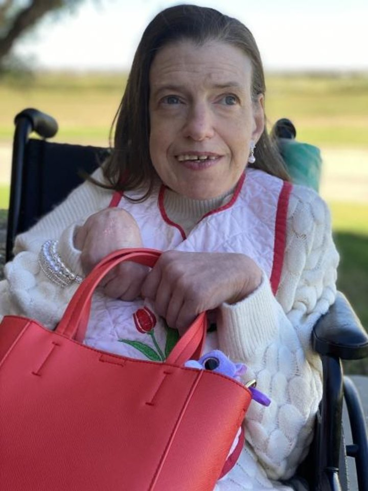Photo -  Pauline, who was the Center of Family Love's first resident, is shown in a recent photo taken at the Okarche center. [Photo provided]