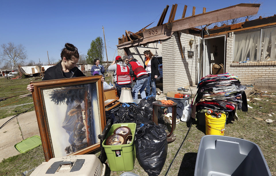 Photo - Family and friends help remove items from Joetta Strain's house in the 900 block of NW 2. She has lived in the house since 1973. Neighborhood  between NW 5 and Main Street, and between Telephone Rd. and Santa Fe in Moore.  Thursday morning, March 26, 2015, the day after a tornado damaged homes and a school Wednesday evening. Photo by Jim Beckel, The Oklahoman