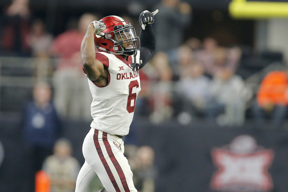 Photo - Oklahoma's Tre Brown (6) celebrates after a safety during the Big 12 Championship football game between the Oklahoma Sooners (OU) and the Texas Longhorns (UT) at AT&T Stadium in Arlington, Texas, Saturday, Dec. 1, 2018.  Oklahoma won 39-27. Photo by Bryan Terry, The Oklahoman