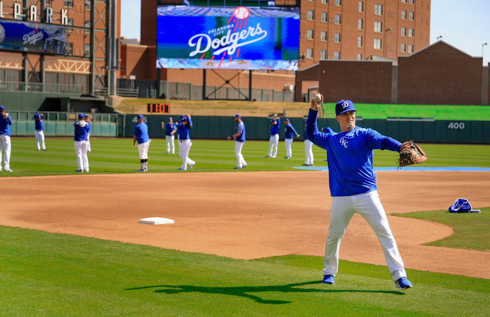 Photo - Oklahoma City Dodgers manager Travis Barbary warms up with the team before practice at the Chickasaw Bricktown Ballpark in Oklahoma City, Okla. on Tuesday, April 2, 2019. The Dodgers will open the season on Thursday against San Antonio.  Photo by Chris Landsberger, The Oklahoman