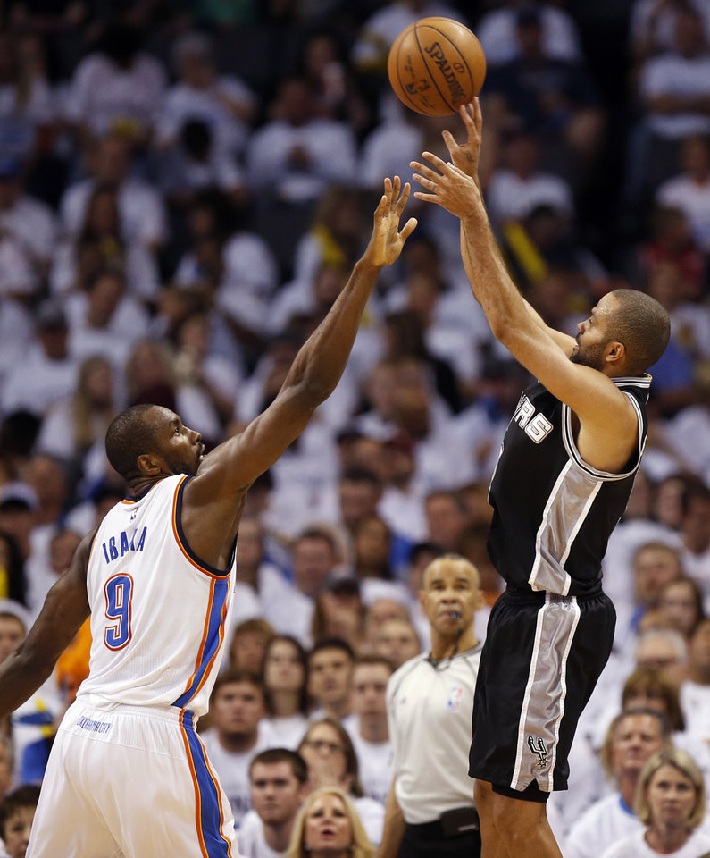 Photo - San Antonio's Tony Parker (9) shoots against Oklahoma City's Serge Ibaka (9) during Game 4 of the Western Conference semifinals between the Oklahoma City Thunder and the San Antonio Spurs in the NBA playoffs at Chesapeake Energy Arena in Oklahoma City, Sunday, May 8, 2016. Oklahoma City won 111-97. Photo by Nate Billings, The Oklahoman