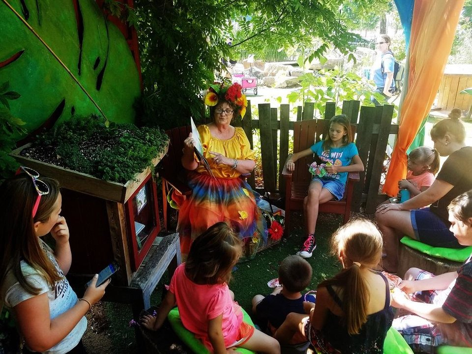 Photo - Youngsters listen to story time during the 2017 Children's Garden Festival in the Myriad Botanical Gardens. [Leslie Spears photo]