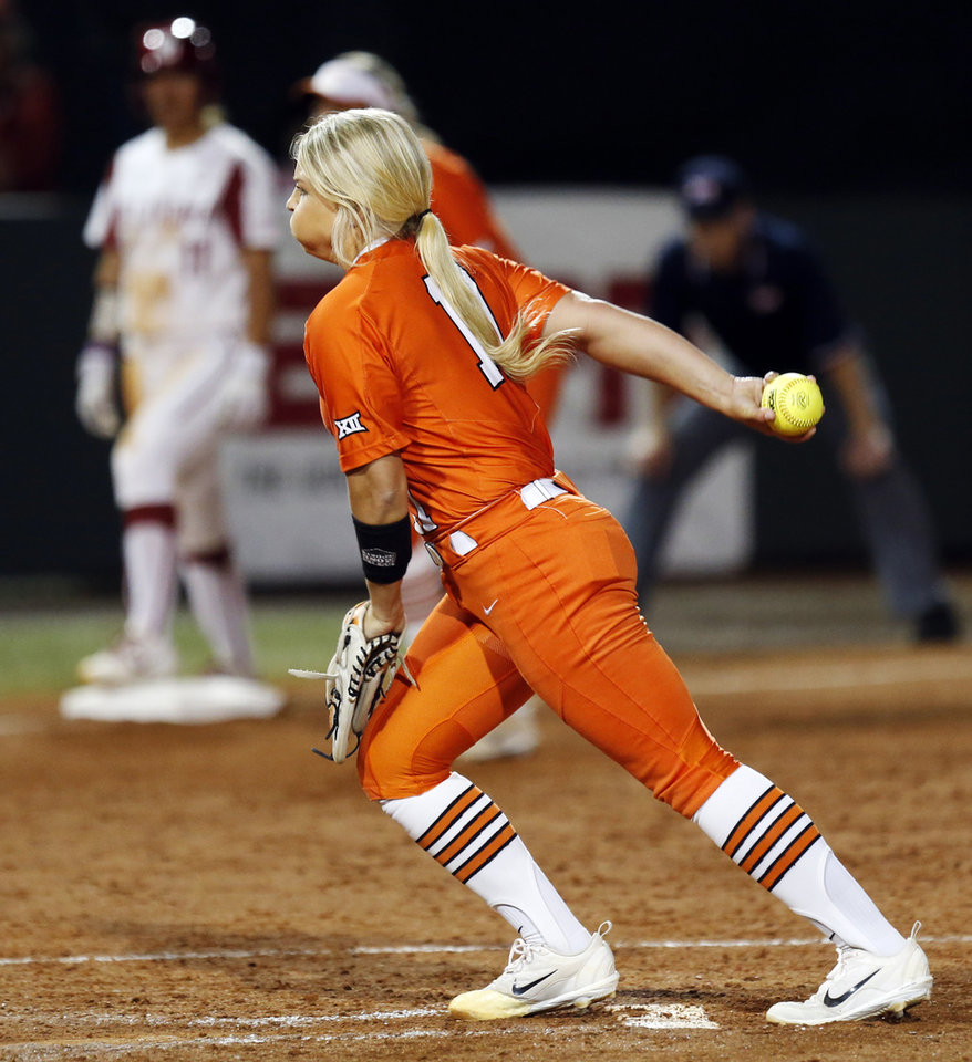 Photo - OSU's Samantha Clakley (11) pitches during a Bedlam college softball game between the Oklahoma Sooners (OU) and Oklahoma State Cowgirls (OSU) at Marita Hynes Field in Norman, Okla., Saturday, May 5, 2018. OU won 7-0. Photo by Nate Billings, The Oklahoman