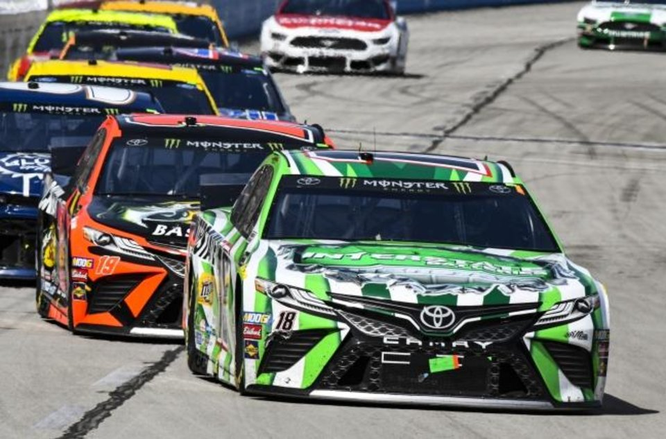 Photo -  Kyle Busch leads the pack heading into turn 1 at Texas Motor Speedway on Sunday. Busch ended up finishing 10th in the race. [AP Photo/Larry Papke]