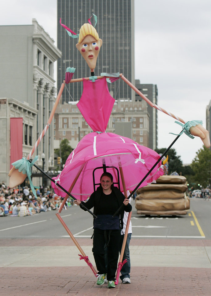 Photo - Julie Barnes 17 of Weatherford controls one of the Puppet Ballerinas in the Oklahoma Centennial Parade Saturday, Oct. 14, 2007 BY JACONNA AGUIRRE/THE OKLAHOMAN.