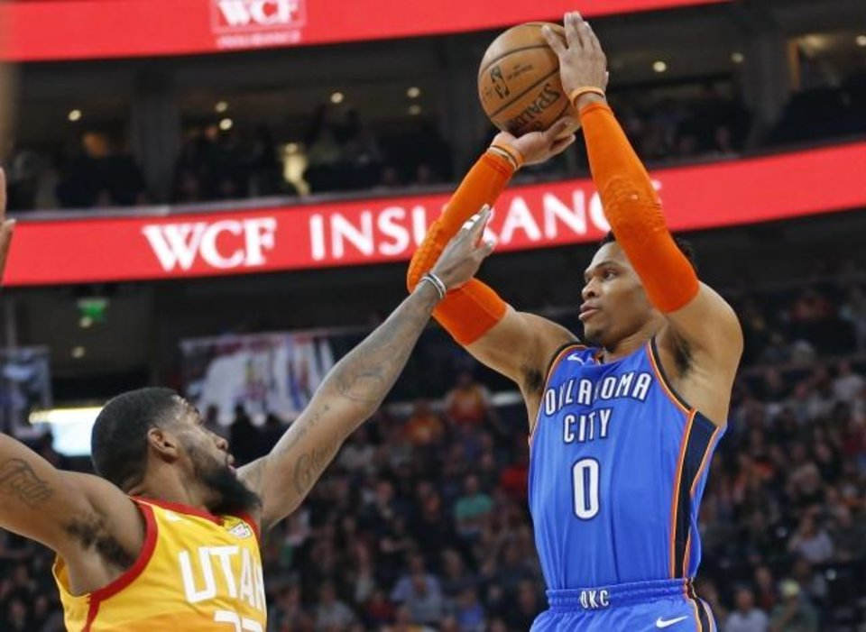 Photo -  Oklahoma City Thunder guard Russell Westbrook, right, shoots as Utah forward Royce O'Neale defends during Monday night's NBA game in Salt Lake City. [AP Photo/Rick Bowmer]
