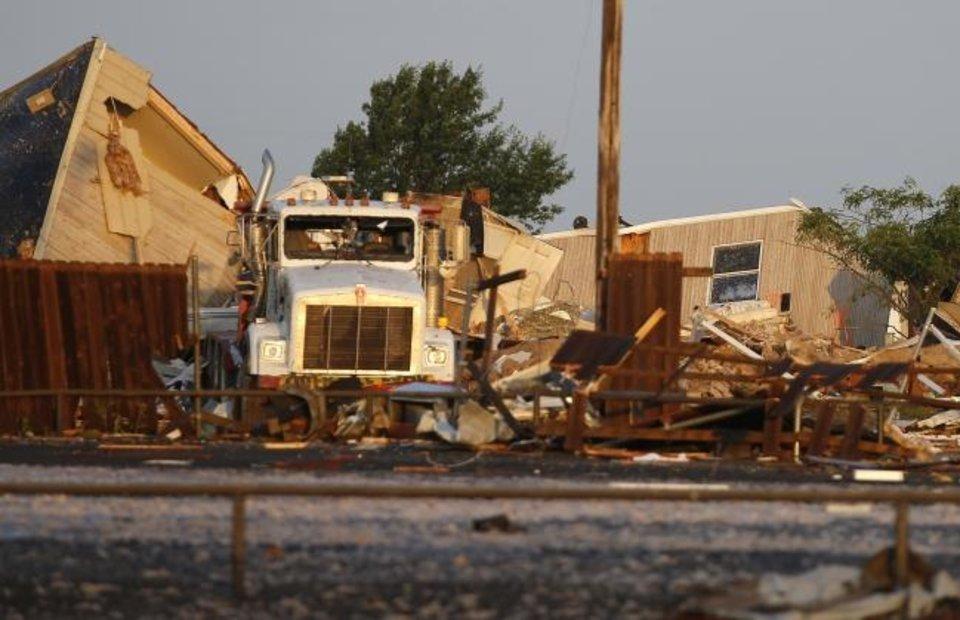 Photo -  Debris lies on the ground near mobile homes that were damaged after a tornado moved through the area in El Reno, Okla., Sunday, May 26, 2019. The deadly tornado leveled a motel and tore through the mobile home park near Oklahoma City overnight. (Bryan Terry/The Oklahoman via AP)