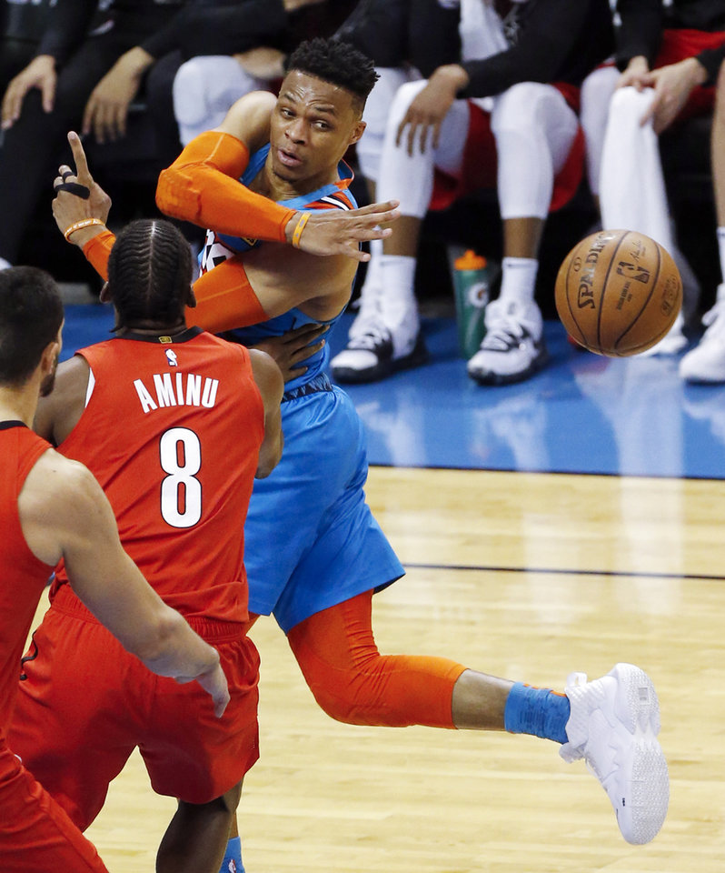 Photo - Oklahoma City's Russell Westbrook (0) passes the ball away from Portland's Al-Farouq Aminu (8) in the second quarter during Game 3 in the first round of the NBA playoffs between the Portland Trail Blazers and the Oklahoma City Thunder at Chesapeake Energy Arena in Oklahoma City, Friday, April 19, 2019. Photo by Nate Billings, The Oklahoman