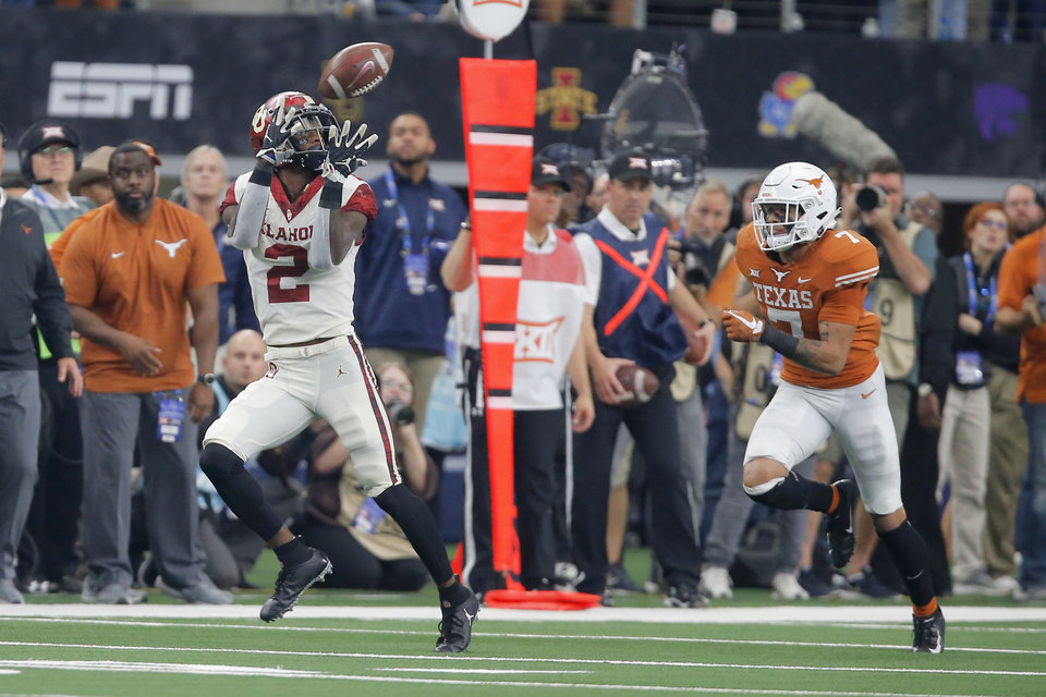Big 12 championship: Grant Calcaterra's one-handed TD ...