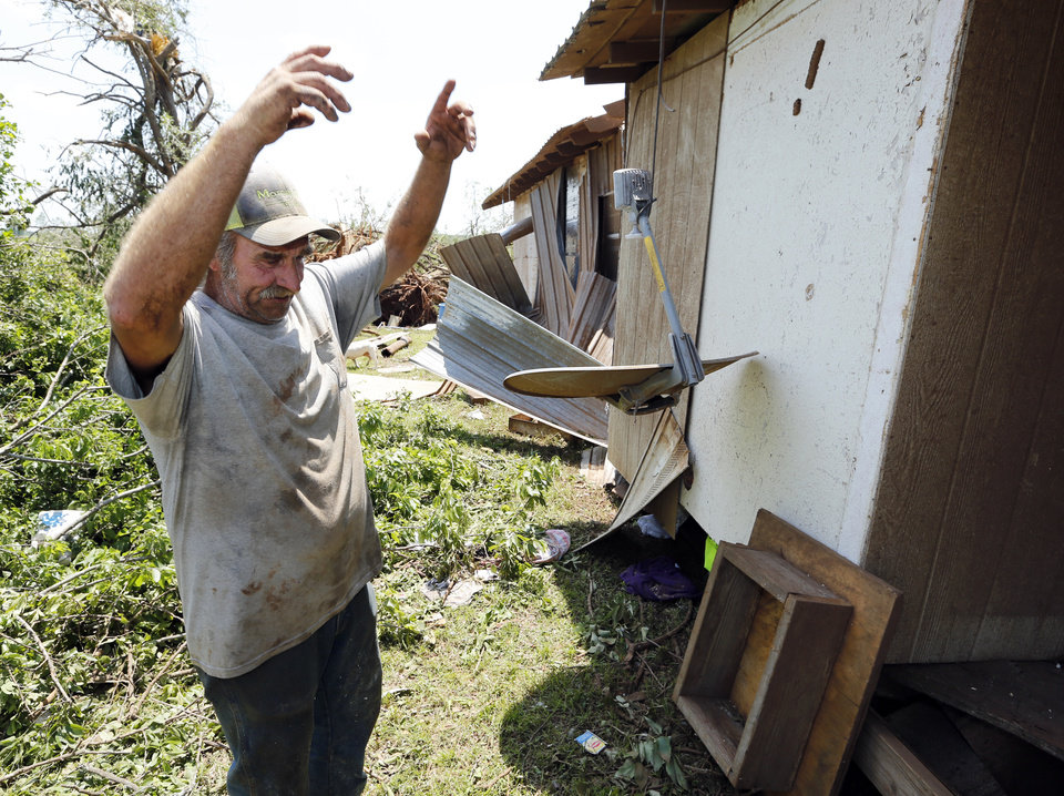 Photo -  Curtis Tweedy illustrates the motion he felt inside his home as it was shifted five feet from its foundation during a May tornado in Connorville. [Photo by Steve Sisney, The Oklahoman Archives]
