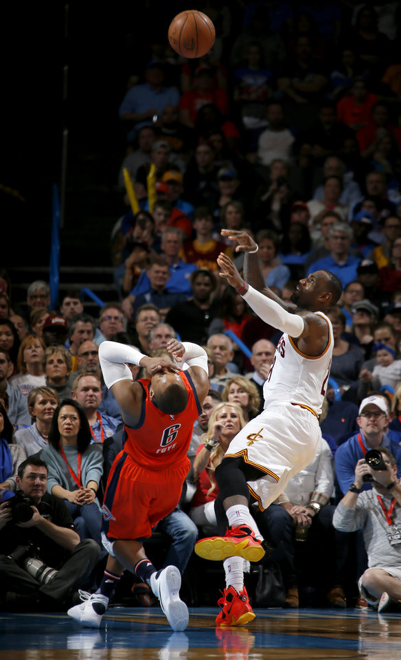 Photo - Oklahoma City's Randy Foye (6) fouls Cleveland's LeBron James (23) as he shoots during an NBA basketball game between the Oklahoma City Thunder and the Cleveland Cavaliers at Chesapeake Energy Arena in Oklahoma City, Sunday, Feb. 21, 2016. Photo by Bryan Terry, The Oklahoman