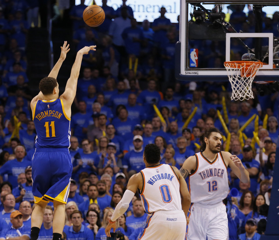 Photo - Golden State's Klay Thompson (11) shoots next to Oklahoma City's Russell Westbrook (0) and Steven Adams (12) during Game 6 of the Western Conference finals in the NBA playoffs between the Oklahoma City Thunder and the Golden State Warriors at Chesapeake Energy Arena in Oklahoma City, Saturday, May 28, 2016. Photo by Sarah Phipps, The Oklahoman