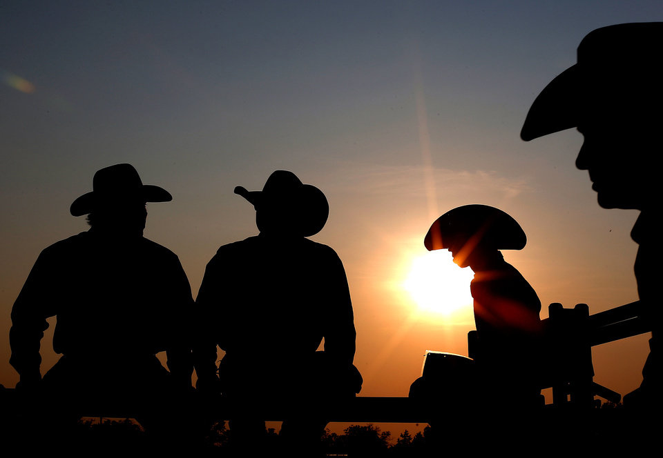 Photo -  Cowboys wait for the beginning of the International Finals Youth Rodeo in Shawnee, Okla., Sunday, July 7, 2013. Photo by Sarah Phipps, The Oklahoman
