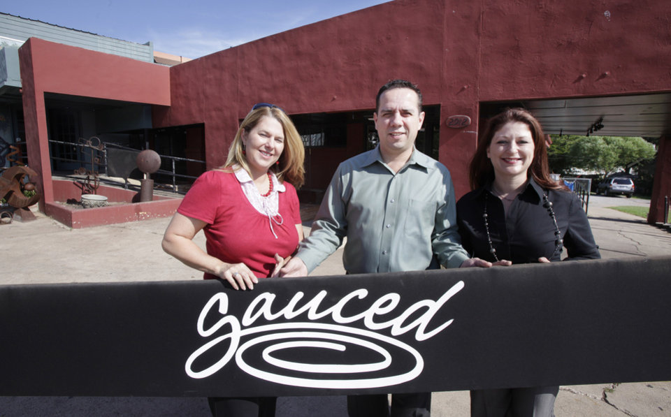 Photo -  Lesley Rawlinson, Joe Jungmann (CQ JOE), and Elise Fischbein in front of Sauced, 2912 Paseo Drive, in Oklahoma City Wednesday, Sept. 15, 2010. Photo by Paul B. Southerland, The Oklahoman