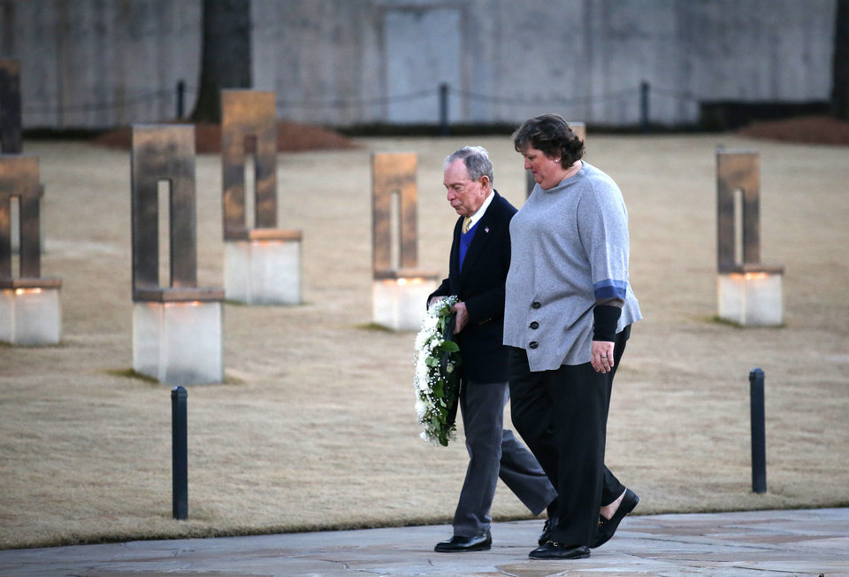 Photo - Democratic presidential candidate and former New York City Mayor Michael Bloomberg and Oklahoma City National Memorial and Museum Executive Director Kari Watkins tour the memorial on Saturday, Feb. 8, 2020. [Sarah Phipps/The Oklahoman]