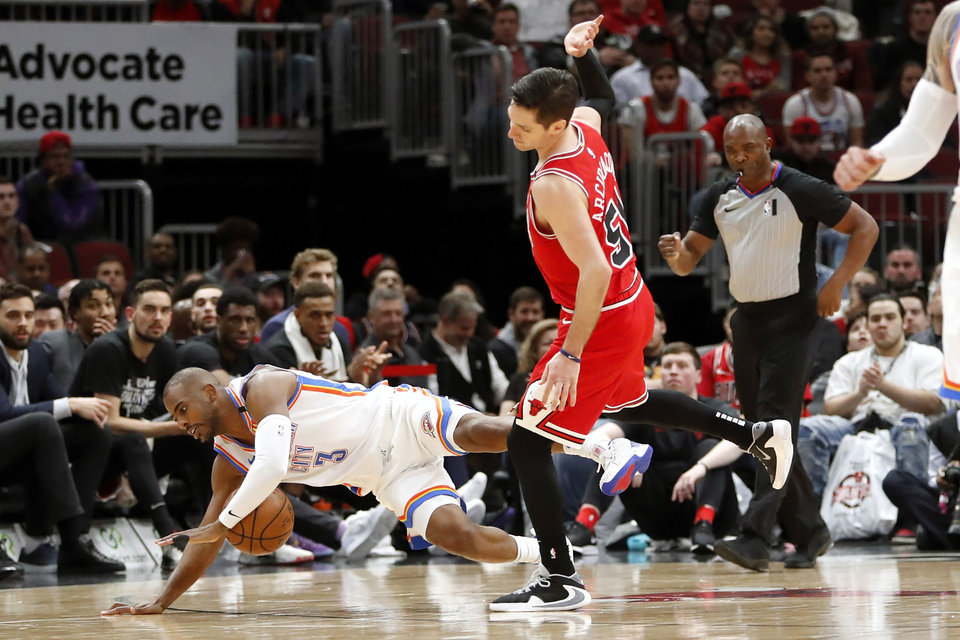 Photo - Chicago Bulls' Ryan Arcidiacono, right, knocks Oklahoma City Thunder's Chris Paul to the floor during the first half of an NBA basketball game Tuesday, Feb. 25, 2020, in Chicago. (AP Photo/Charles Rex Arbogast)