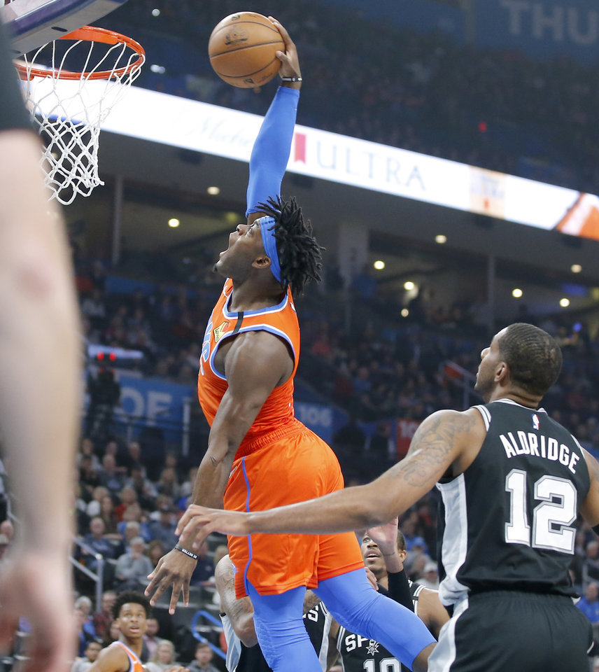 Photo - Oklahoma City's Luguentz Dort (5) dunks the ball beside San Antonio's LaMarcus Aldridge (12) during an NBA basketball game between the Oklahoma City Thunder and the San Antonio Spurs at Chesapeake Energy Arena in Oklahoma City, Sunday, Feb. 23, 2020. [Bryan Terry/The Oklahoman]