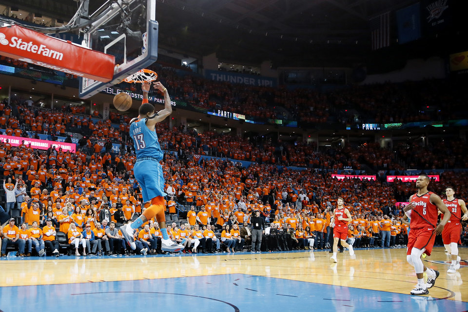 Photo - Oklahoma City's Paul George (13) dunks the ball at the end of Game 3 in the first round of the NBA playoffs between the Portland Trail Blazers and the Oklahoma City Thunder at Chesapeake Energy Arena in Oklahoma City, Friday, April 19, 2019. Oklahoma City won 120-108. Photo by Bryan Terry, The Oklahoman