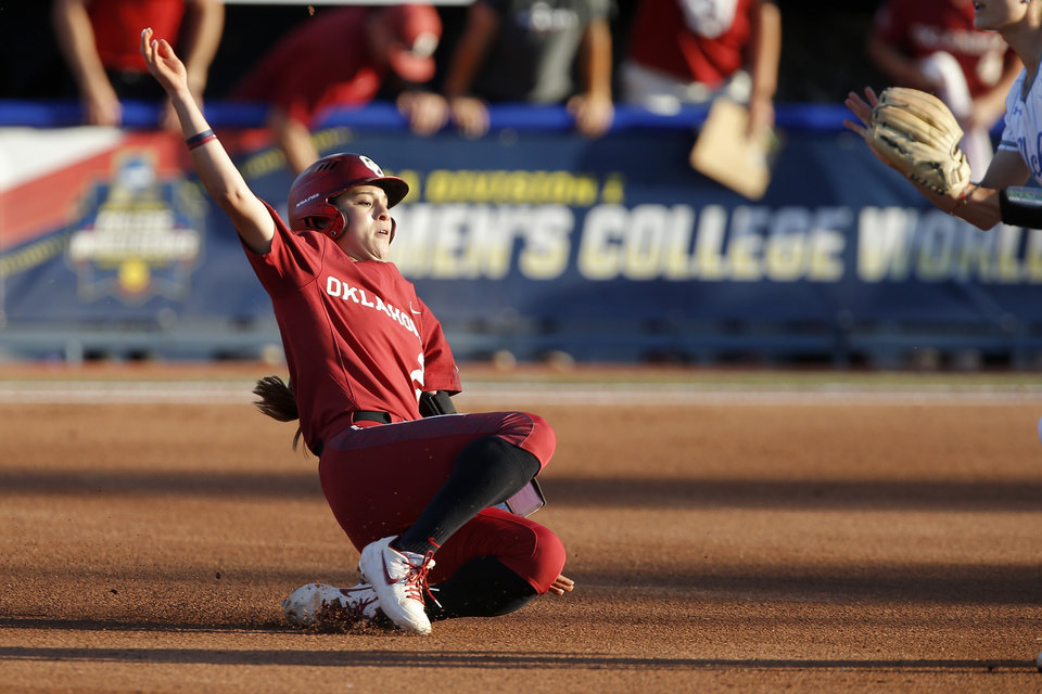 Photo - Oklahoma's Sydney Romero (2) slides to second after hitting a double in the first inning of the second NCAA softball game in the championship series of the Women's College World Series between Oklahoma and UCLA at USA Softball Hall of Fame Stadium in Oklahoma City, Tuesday, June 4, 2019. [Bryan Terry/The Oklahoman]