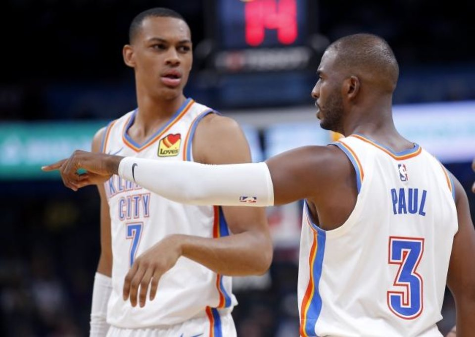 Photo -  Oklahoma City's Chris Paul (3) talks with Darius Bazley (7) during a preseason game Oct. 10 at Chesapeake Energy Arena. [Sarah Phipps/The Oklahoman]
