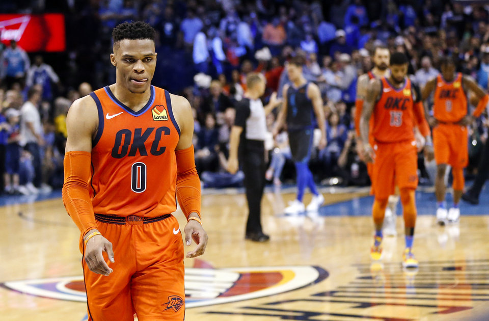 Photo - Oklahoma City's Russell Westbrook (0) leaves the court after an NBA basketball game between the Dallas Mavericks and the Oklahoma City Thunder at Chesapeake Energy Arena in Oklahoma City, Sunday, March 31, 2019. Dallas won 106-103. Photo by Nate Billings, The Oklahoman